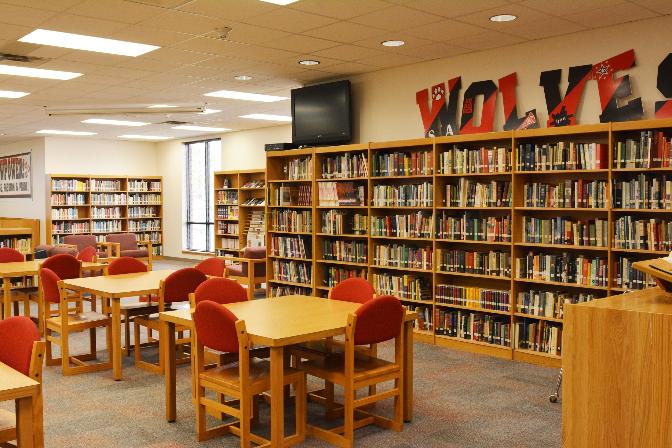 High School library showing a wall of nonfiction books.