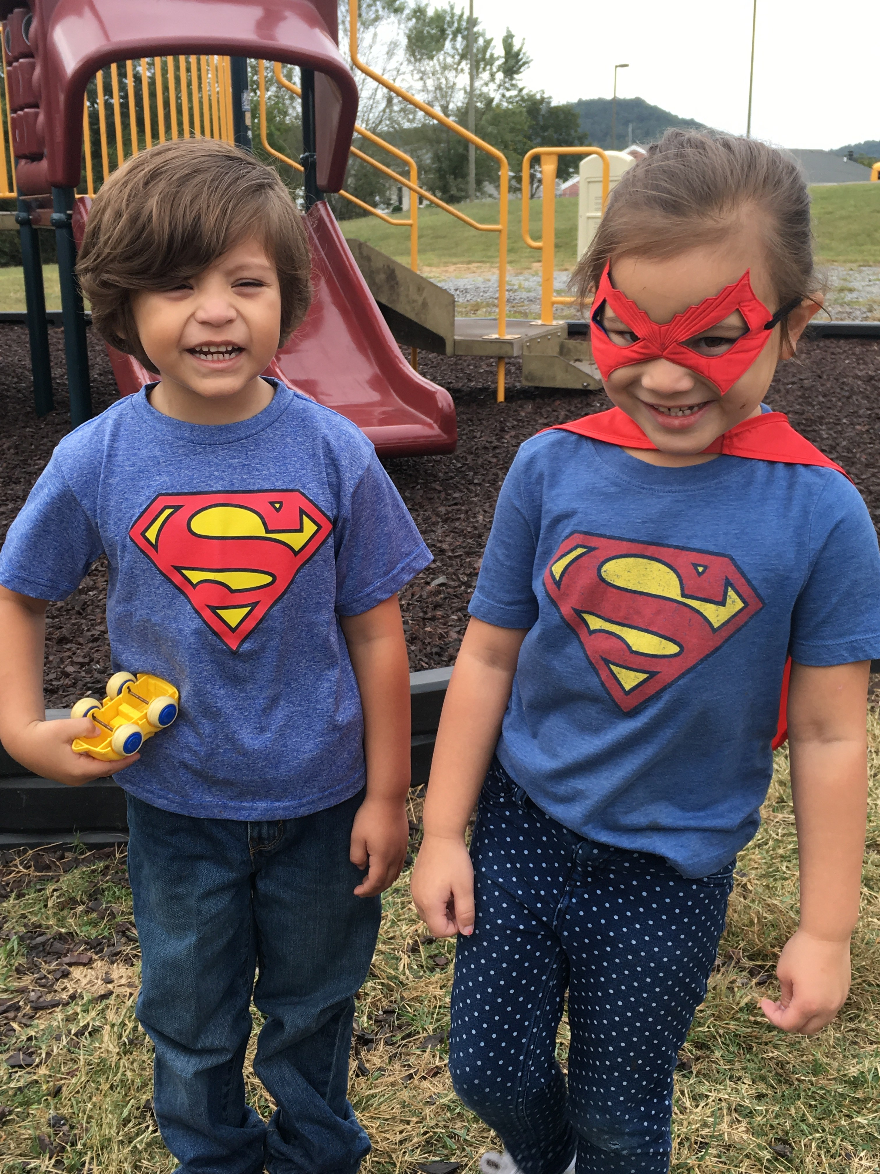 two students dressed in superman tshirts