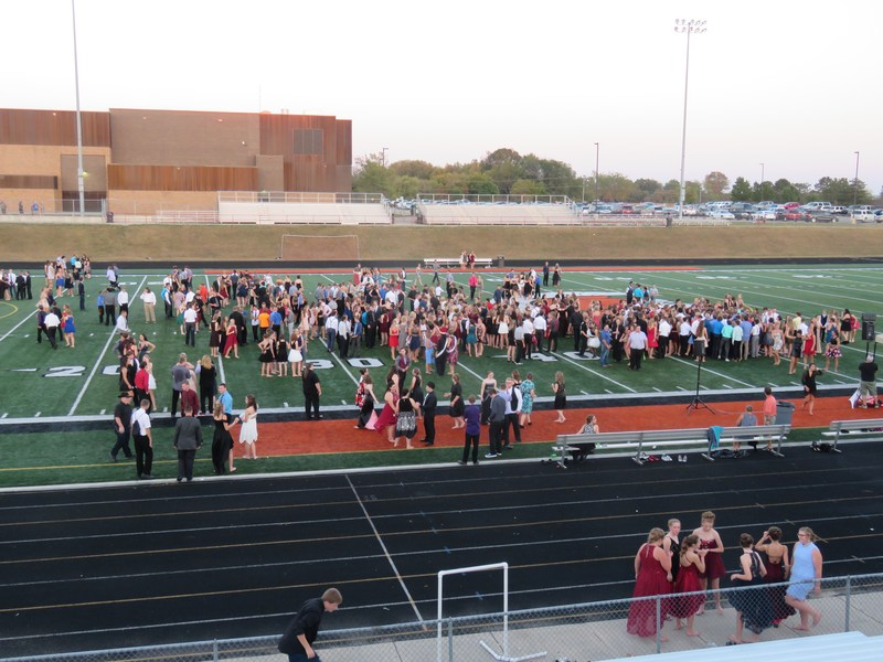 Excessive heat forced the TKHS homecoming dance outside on the football field.