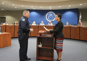 Dr. Platter recognizing Officer Nacua at the Board Meeting