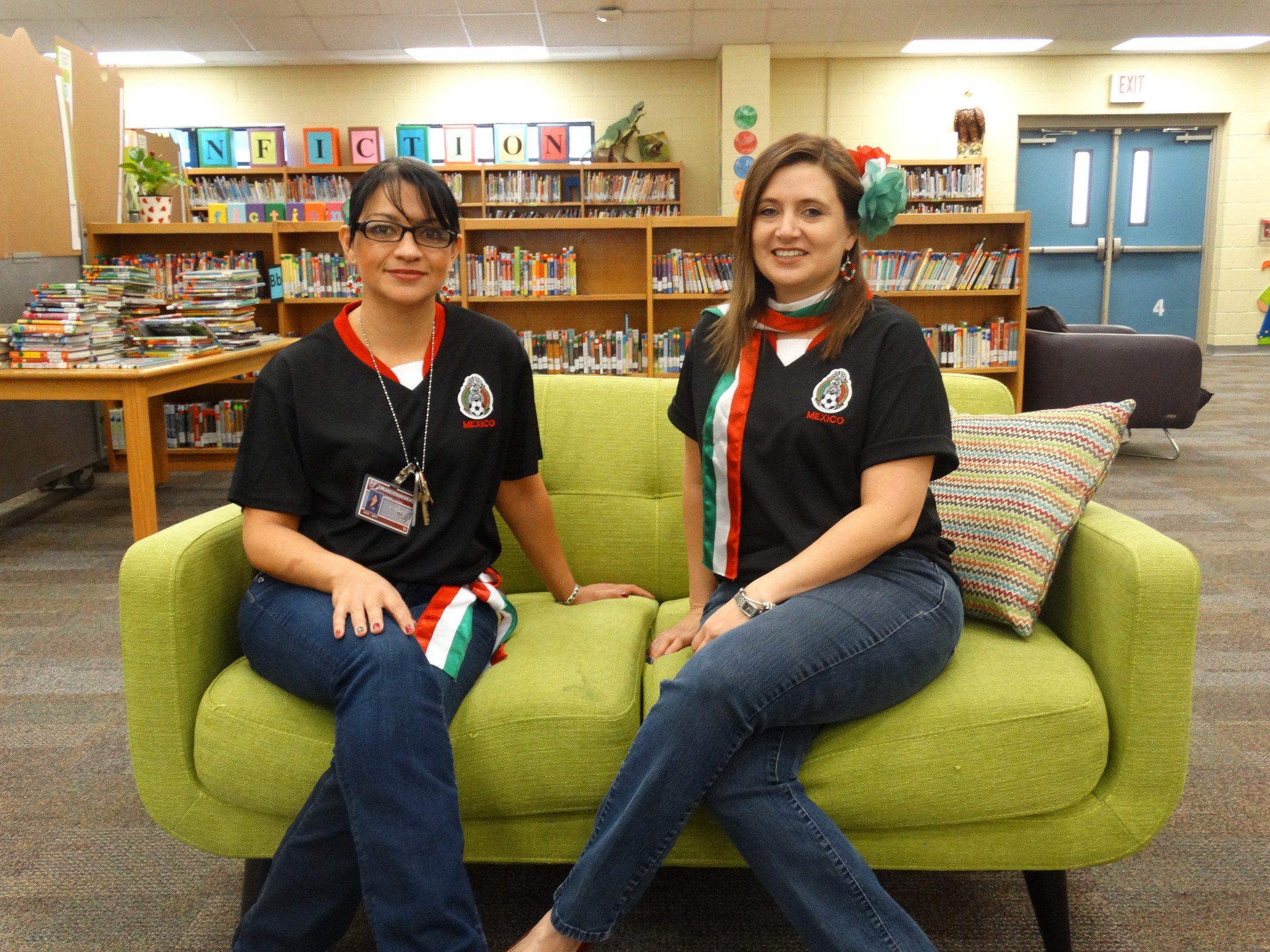 Librarian and library clerk dressed up for 16 de septiembre holiday.
