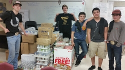 Mr_ Massey_s students with boxes of donated items_.jpg