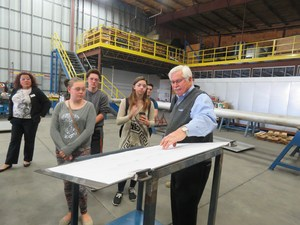 Dave Scharphorn of ChemQuest shows students blueprints used at his company.