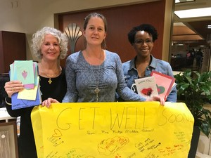 Pine Ridge Middle School counselor Julia Beckham, center, and Congaree Elementary counselor Debbie Manos delivered student-made get-well cards and signs to Palmetto Health earlier this week to give to those still being treated after last weekend's Amtrak train accident.