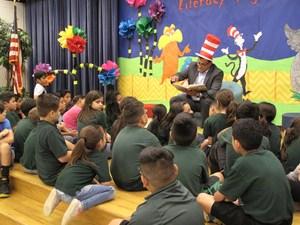 Judge Keno Vasquez reading to the students