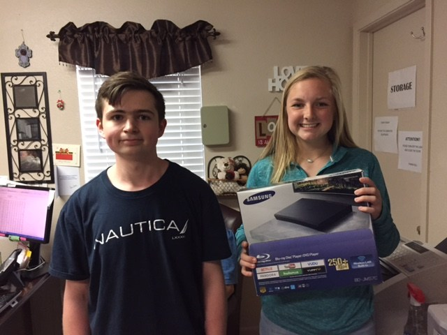 NHS Members donate DVD players to Villa Residential Center.