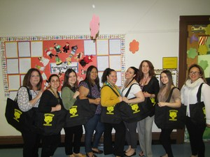 group 1 of teachers holding their totes