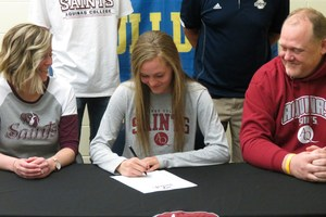 Jaycie signs her letter of intent.