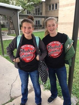 two patti welder student council members showing off their new student council tshirts for the 2017-2018 school year
