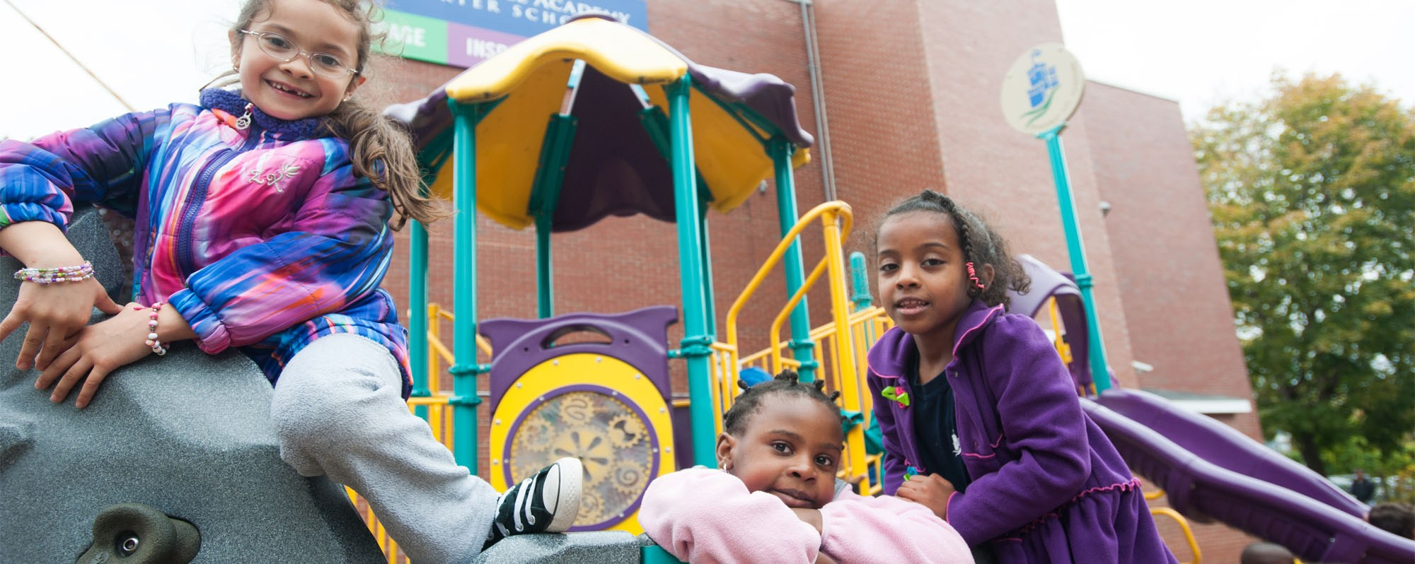Early Childhood students on playground structure