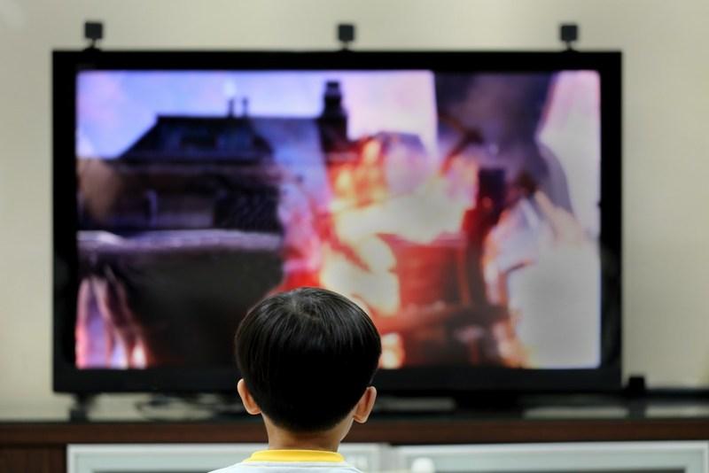 Student watching tv.