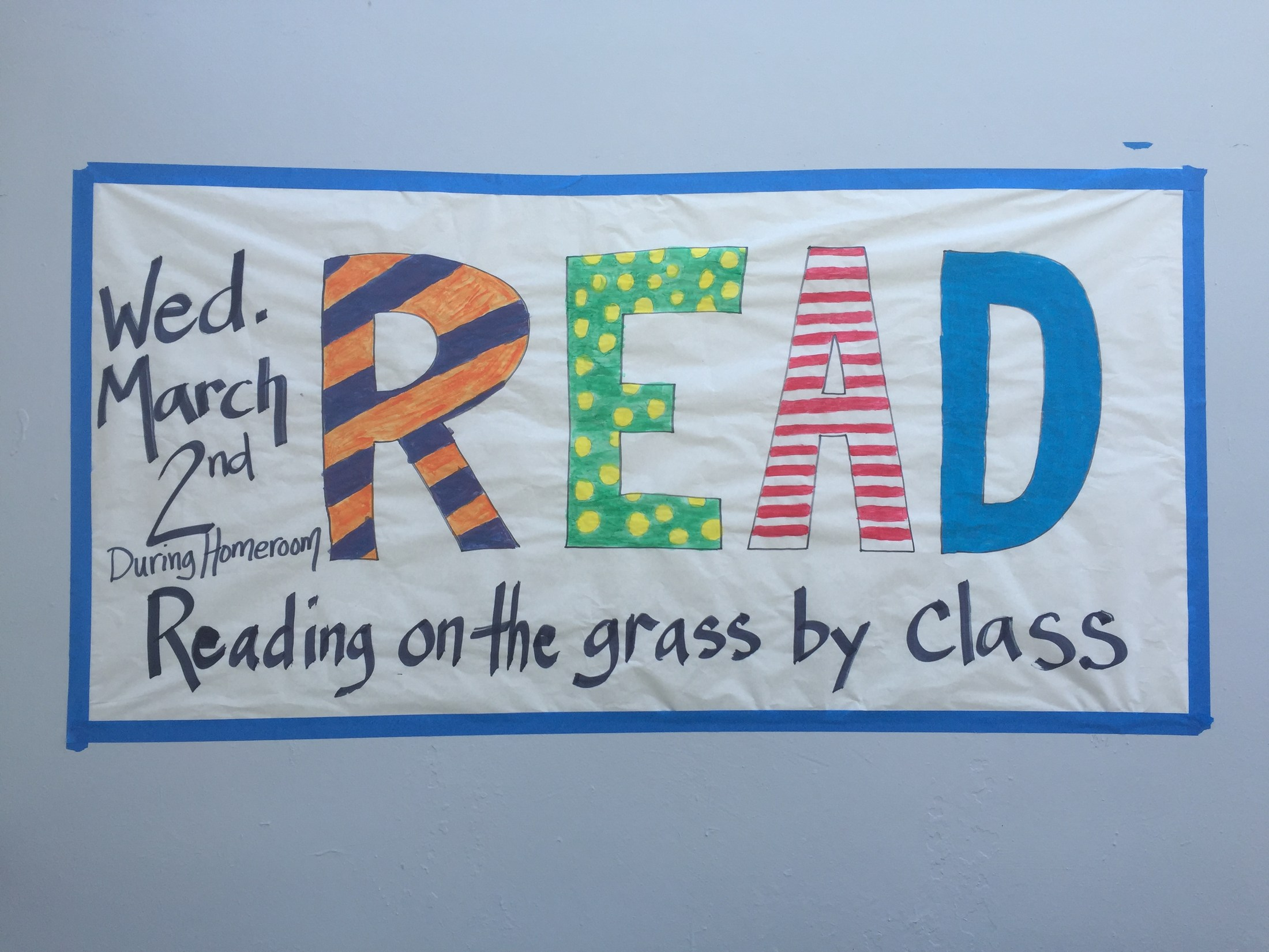 Reading on the Grass by Class banner