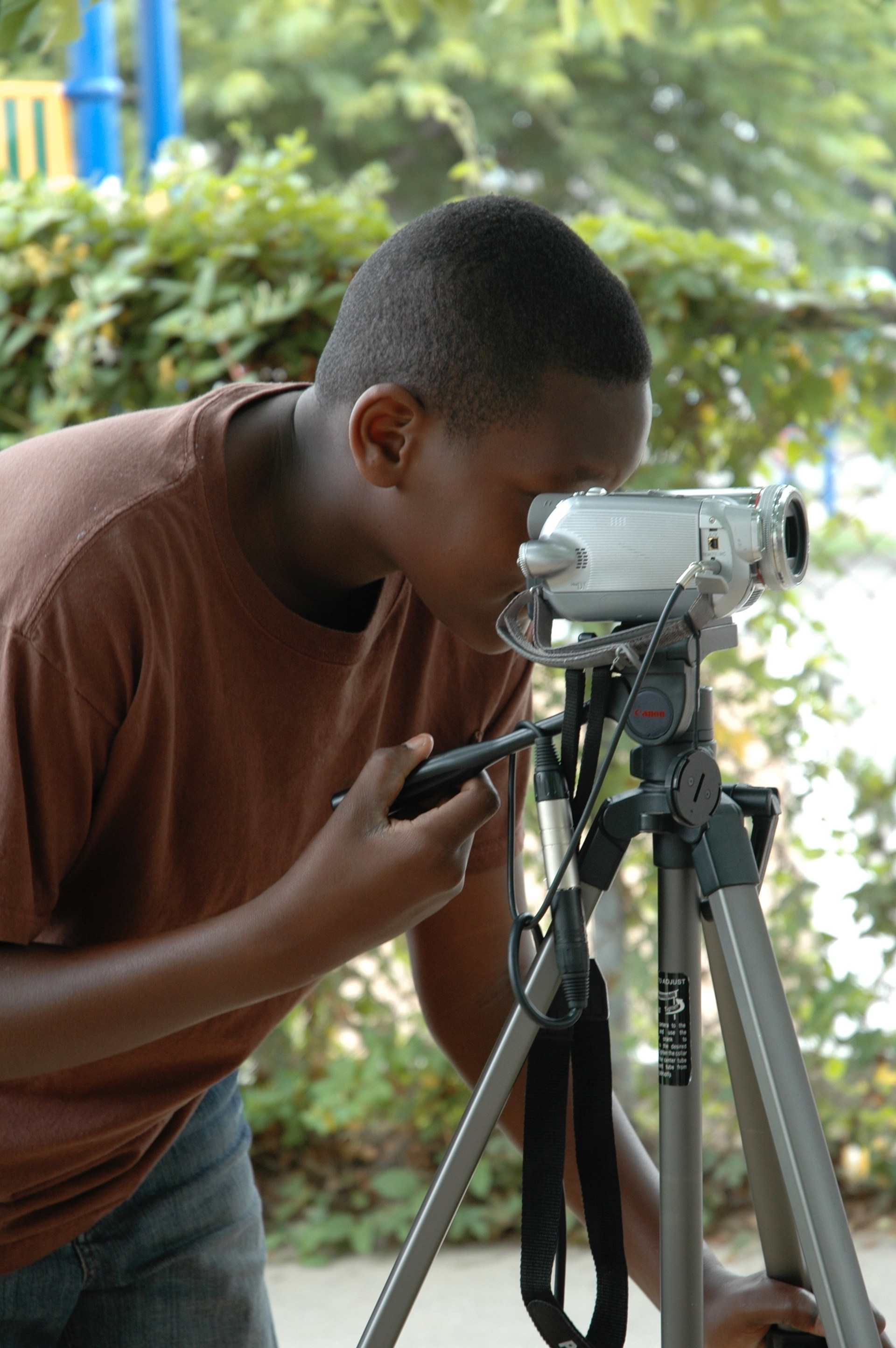A student using a video camera.