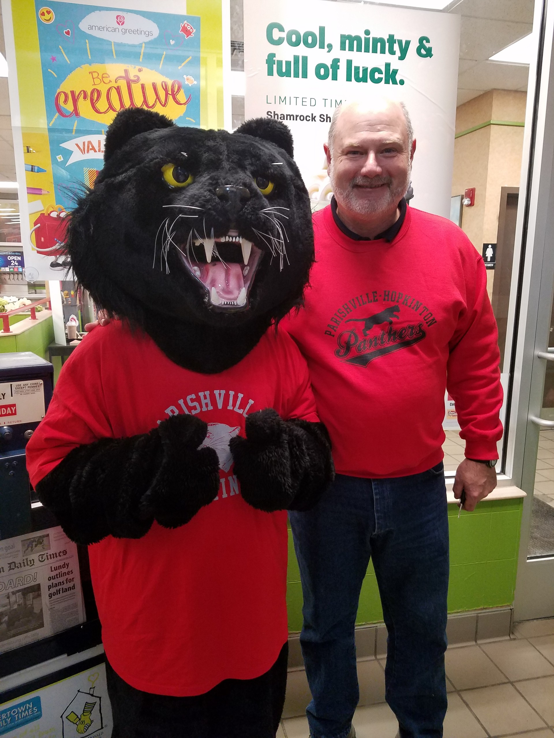 "Dr Collins and ""paws the panther"" mascot"