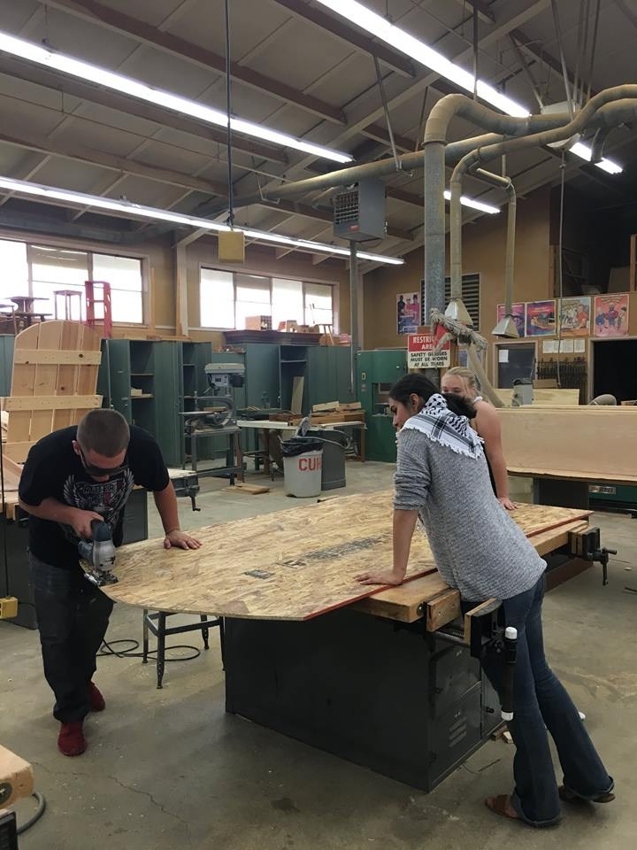Student cutting plywood in the woodshop