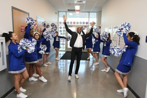 Gladiator Cheerleaders cheer for Instructional Coach James Tillman