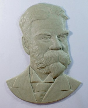 Original artist carving of the Wait image done by artist.