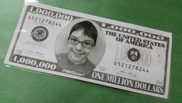 Student face on million dollar bill
