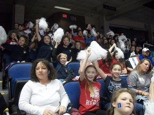 Students, parents, and staff members watch a basketball game at the Greensboro Coliseum.