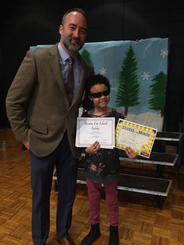 December Student of the Month Phoenix King and Principal Bergeson