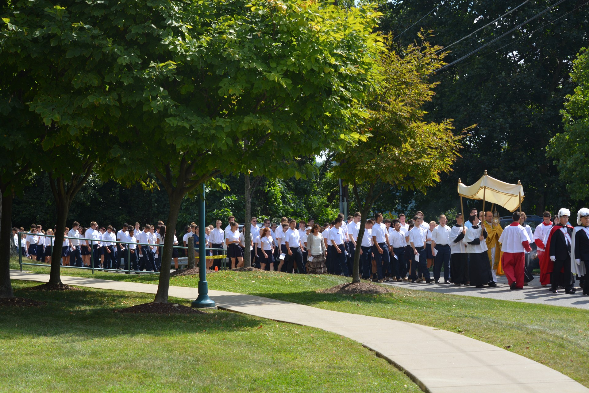 The entire school community participates in the annual eucharistic procession through the OLSH campus