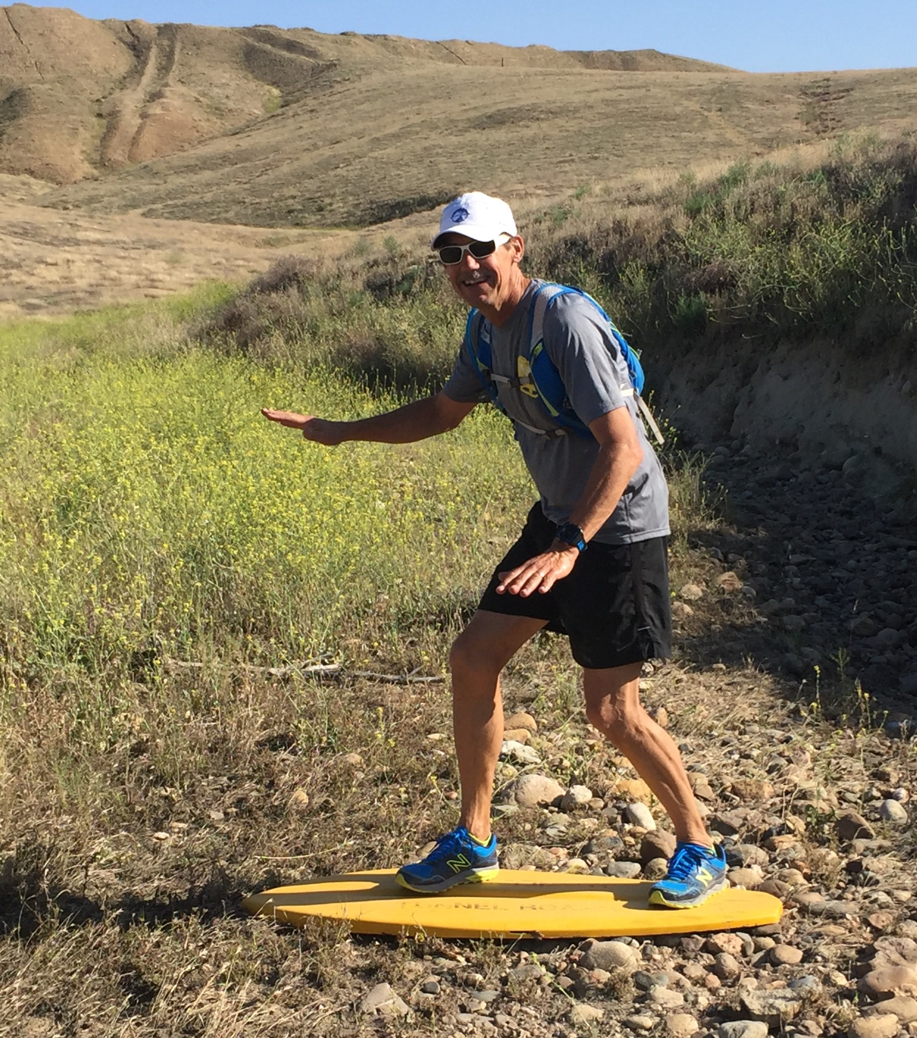Pretending to surf during a trail run.