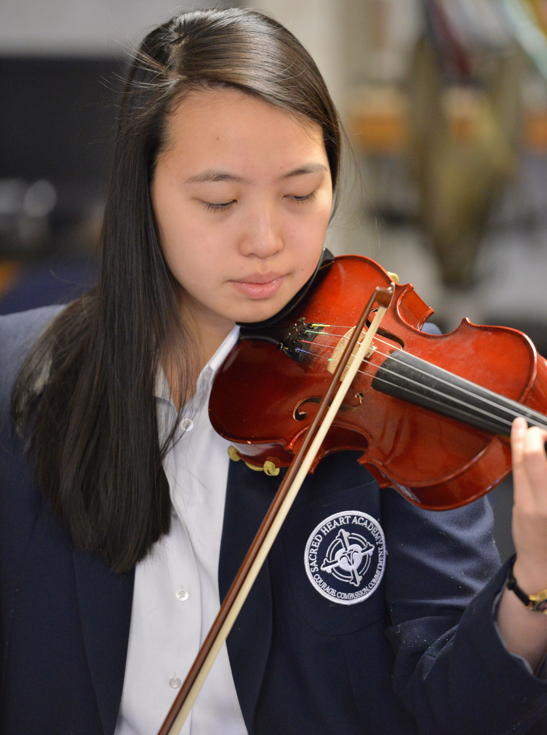 SHA student playing violin