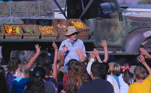 Farmer Bob asking students questions during the mini-farmer's market.
