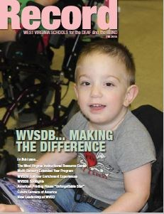 cover of Fall 2015 Record showing a small boy in an adaptive chair