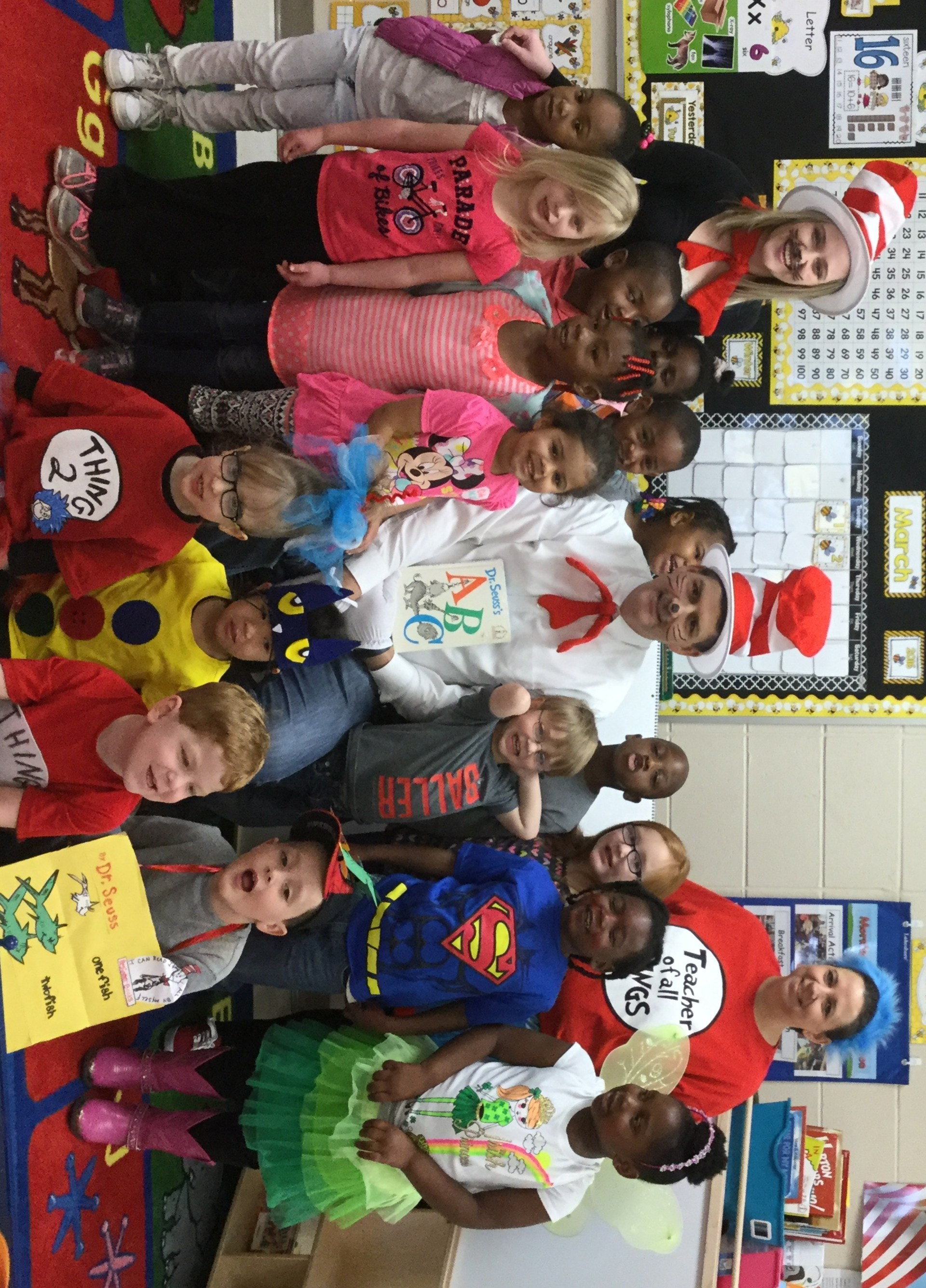 Mayor Dennis Striping aka Cat in the Hat reads to the PRE-K class on Read Across America Day.