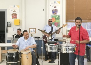 The Ciegos del Barrio performing at lunch.