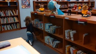 A student selects a book.