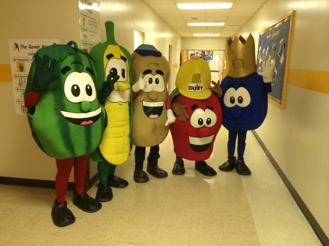 People in Fruit and Vegetable Costumes