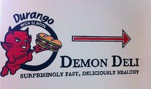 Photo of the Demo Deli sign