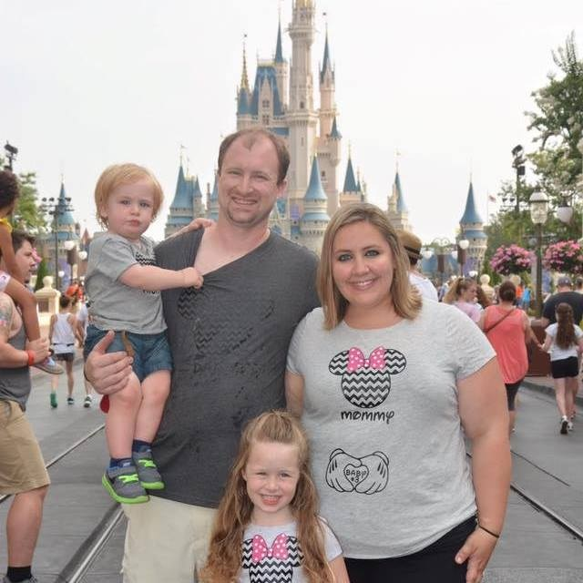 Tunison family in Disney World in front of Cinderella's castle: Mr.T., Aiden, Savannah, Mrs.T