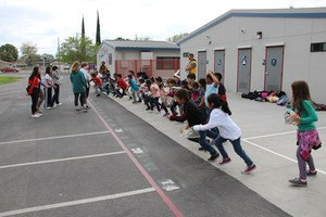 Students running to find hidden eggs