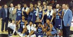 A picture of the varsity boys basketball team and the coaches just after winning the 5A state championship game.