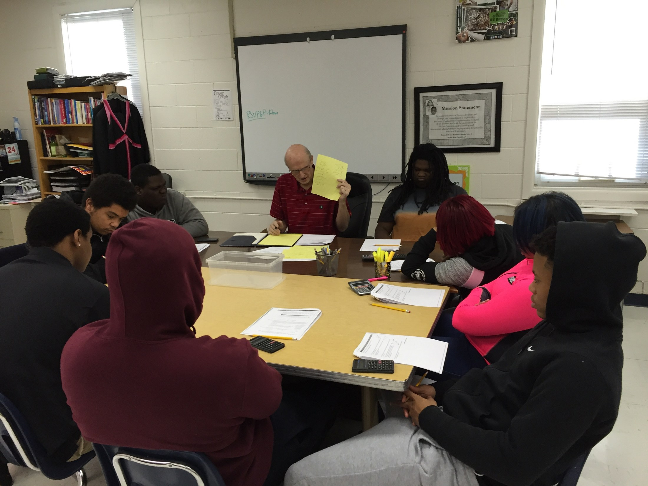 Students working with tutor Mr. Stewart