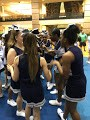 Cheerleaders huddle