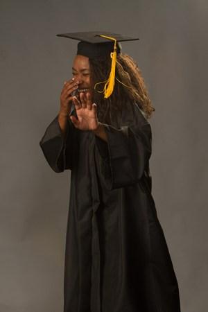 Aleea Moore taking graduation photos at school.