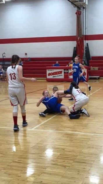 8th graders Hailey Kilgore and Abby Strunk battle for a loose ball