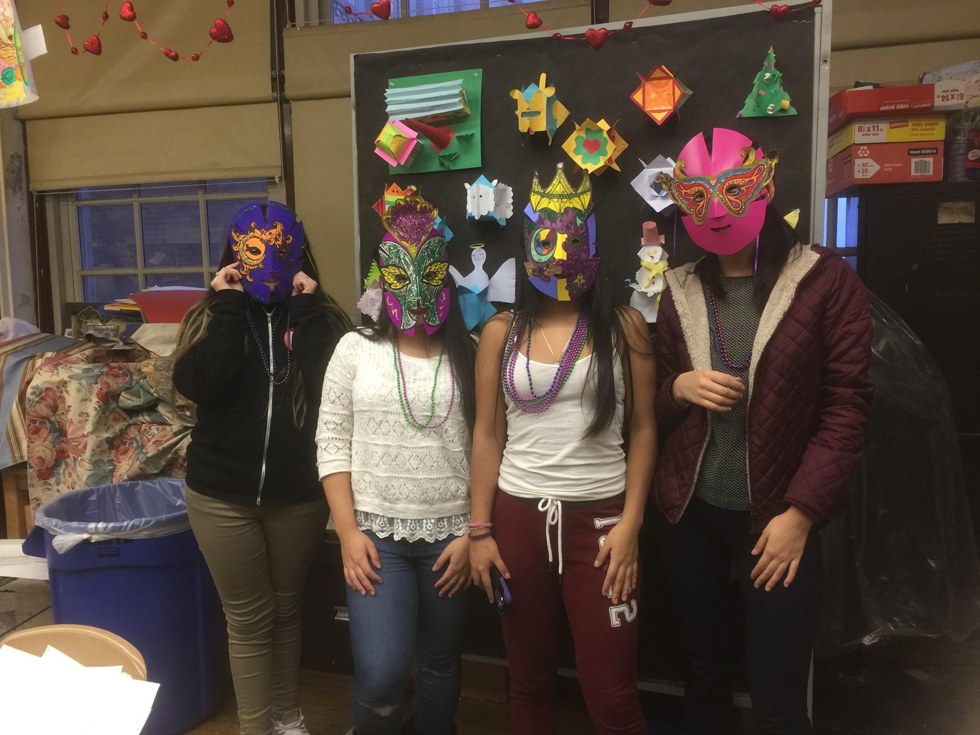 Students wearing Mardi gras masks