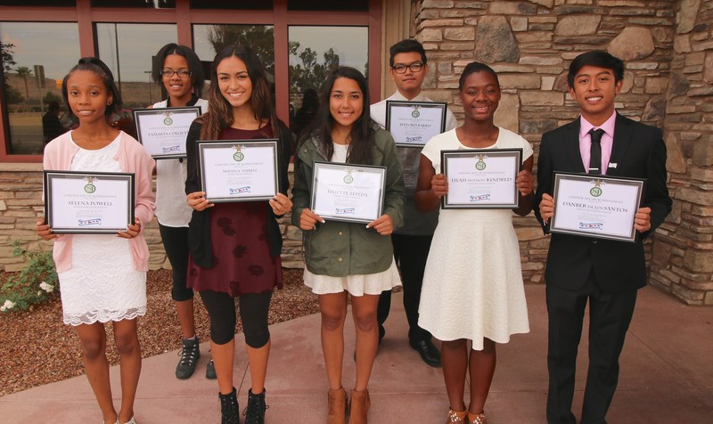 Selena Powell, Mikayla Ambriz, Lissette Zepeda, Lilah Hudson Kindred, and Jevford Barro posing with their Student of the Month plaque.