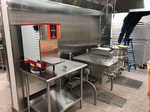 Cooks are busy preparing the new kitchen for feeding students on Jauary 2, 2018.