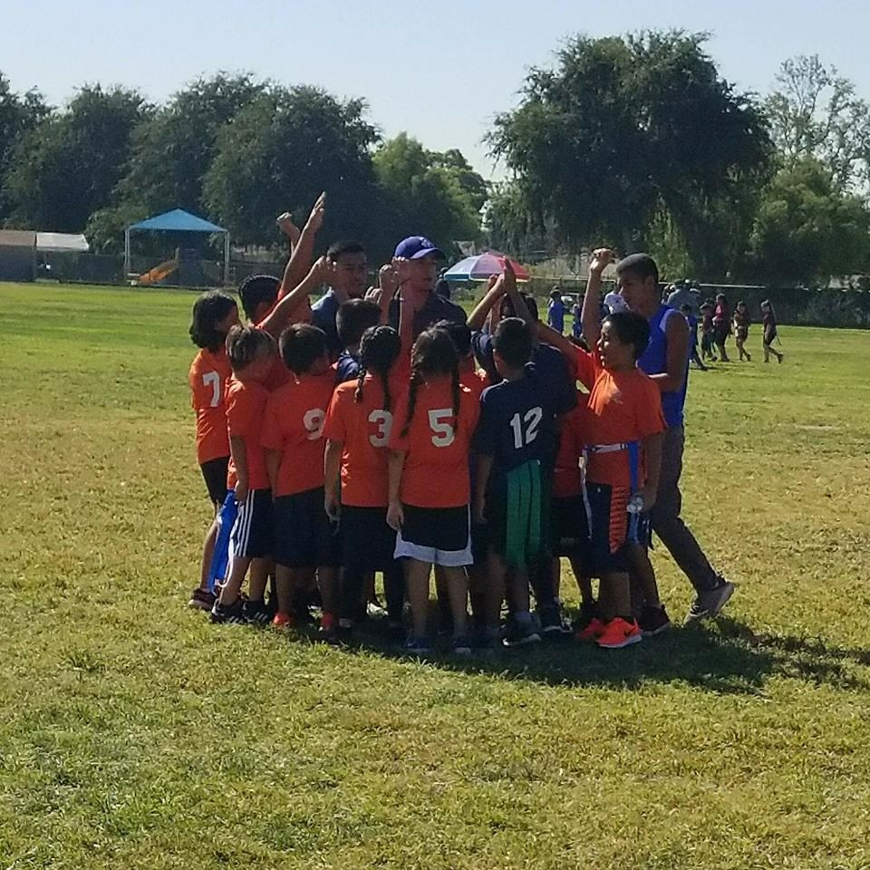 Flag Football Team Huddle