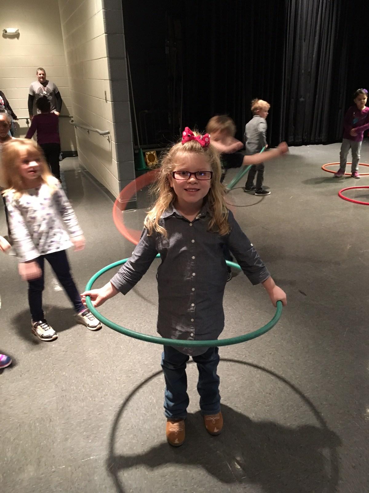 student hula hooping