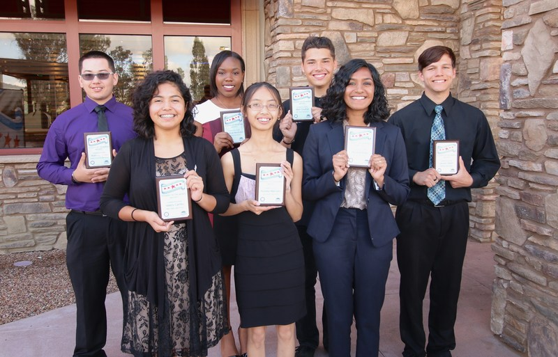 Hemet and San Jacinto's Students of the Month standing with their plaques