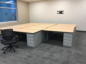 Getting the new desks put together for teachers.