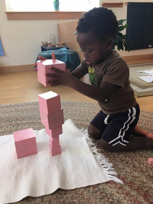 Boy stacking tower