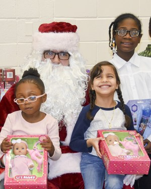 2 young students with Santa